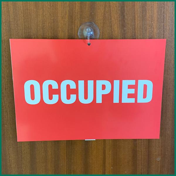 Bathroom flip sign for the door saying 'OCCUPIED